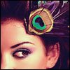 angryoldhag: Picture of a peacock feath in a model's hair (I am watching you)