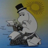 ossamenta: Moominpappa sitting on a rock in the sea, writing on his typewriter (Muminpappa skriver)