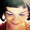amihan: close-up image of audrey tautou as amelie poulain in 'amelie' wearing a polka-dotted top and smiling ([amelie] smiles & dots)