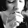 amihan: close-up black and white image of audrey tautou as amelie poulain in 'amelie' taking a shot ([amelie] drink)