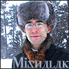 mishalak: Mishalak wearing a furry hat in front of snowy pines. (SnowII)