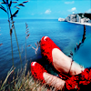 pensnest: Bright red shoes against the seashore (Red Shoes)