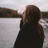 lifeingeneral: Woman drinking coffee by river (Stock:MorningCoffee)