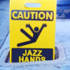 jenna_thorn: hazard warning sign of falling, with jazz hands replacing text. (jazzhands)