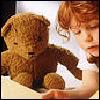 jenna_thorn: little girl reading to her teddy bear (reading)