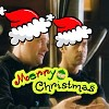 lilyleia78: John and Rodney wearing Santa hats captioned Merry Christmas (SGA: J/R Christmas)