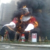 aquenigmatic: A huge plastic Santa burns with black billowing smoke like a Santa demon from hell. (Santa holidays fail)