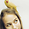 tree: a bird perched on a girl's head ([else] is in my tree)