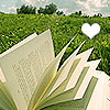 orbitaldiamonds: open book on grass, trees and sky in distance, white heart ([ books ] book grass heart sunny day)