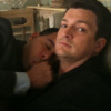 carnivorousgiraffe: Nathan Fillion looking at the camera with Jon Huertas in his lap, posed like a sleeping baby. (Naptime)