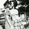 aphrodite_mine: two women wearing army hats steal a kiss (random - vintage love)