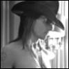 jmtorres: Stacee Jaxx has a hat, shades, and a distinct lack of shirt. Black and white profile. (mod hat, stacee jaxx, kinkofages, rock of ages (2012))