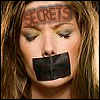 kaleidoscope_eyes: A crying woman with black tape over her mouth. Engraved on forehead is: secrets. (woman secrets)