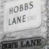 "raven: black and white street sign: ""Hobbs Lane"" (quatermass - hobbs end)"