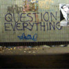 "ext_2208: graffiti on a wall saying ""QUESTION EVERYTHING"" (question everything)"