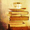 sneezer222: cup of tea on a stack of books (teabooks)