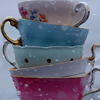 ginandkerosene: five stacked teacups in rain (and don't fucking touch them)