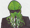 agentcthulhu: knitted yellow-green cthulhu in black suit and sunglasses (sock!agent cthulhu)