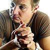 bookblather: Jeremy Renner with clasped hands, looking to his right. (Peter Edleson : Jeremy Renner)