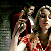 allfireburns: Jo Harvelle, playing with a knife. Dean in the background. (and fuck you too. :))