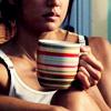 kiki_eng: striped mug held by a woman wearing a sleeveless top (Hawaii Five-0) (mug held by Kono)