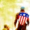 longwhitecoats: Captain America in his uniform and soldier's helmet, walking away from the camera with his old shield on his back (Cap Old Shield)