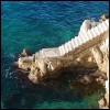 feralkiss: Rocky staircase descending into mediterranean waters. (mediterranean)