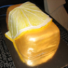 aquaeri: A cake in the shape of a slice of lemon wrapped around a large gold brick (gold brick)