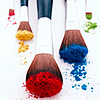 scheherezhad: five various makeup brushes with different pigment powders on them (brushes)