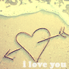 indeliblesasha: Heart made of sticks, in the sand, next to the tide. Text: I love you (Misc - ILU)