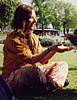 sashajwolf: photo of me sitting on the grass with hands extended (park)