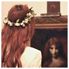 darwin: someone with red hair, with a crown of flowers. she's staring at a pre-raphaelite painting. (wreathed)