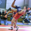jeffthoth: Photo of amateur wrestling, looks like one is going for a pro powerbomb. (Wrestling)