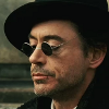 xenacryst: Sherlock Holmes looking over his dark glasses (Holmes: hat and glasses)