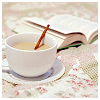 writerlibrarian: open book with a cup of coffee/tea/hot choocolate (Reading)