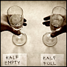"dorinda: Hands reach for two identical glasses, which are labeled ""half empty"" and ""half full"". (halfemptyhalffull)"