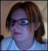 uhhuhlex: Me posing by my isight with new glasses. (Default)