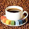 tasyfa: Coloured sugar cubes in a rainbow round a coffee cup (Default)