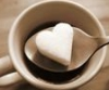 bare_bear: Heart-shaped sugar cube on spoon above tea cup (Tea Love)