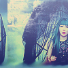 lunchee: 2NE1's Park Bom with green hair holding an umbrella from the 'It Hurts' MV (Bom Umbrella2)