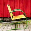 sinensis: old-fashioned yellow lawnchair before a red wall (summer chair)