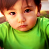 thefourthvine: A picture of my kid looking solemn. (Earthling solemn green)