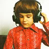sothcweden: child of approx 8 yrs wearing 1970s style shirt and headphones (aural)