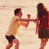 merrily: A picture of Robert Downey, Jr & Susan Downey, frolicking on the beach. (RDJ, susan-downey)
