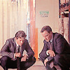 china_shop: Neal and Peter crouching, examining evidence (WC - Neal/Peter crouching)