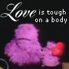 """trickster_tree: A purple muppet holds up his heart; text reads """"Love is tough on a body."""" (tough love)"""