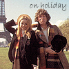 "darchildre: fourth doctor and romana in front of the eiffel tower.  text:  ""on holiday"" (even timelords vacation in paris)"