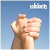norah: Hands clasped together, upraised (solidarity)