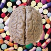 chagrined: A brain superimposed on a bunch of pills (brain on drugs)