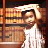 timeasmymeasure: a little girl with holding a book steady on her head (stock: girl with book on her head)